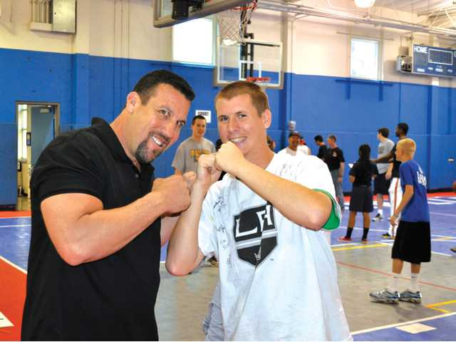 "Mixed martial arts legend ""Big"" John McCarthy poses during the event last year with Special Olympics athlete Matt Adam."