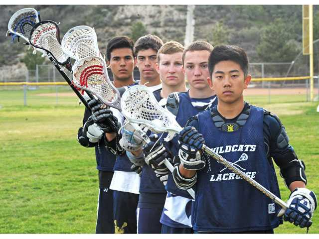 West Ranch lacrosse players, from left, Tony Bendfeldt, Ryan Mendes, Matt Chance, Garrett Clark, and Daniel Lee. Photo by Jonathan Pobre