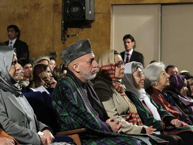 Afghan President Hamid Karzai sits among the audience prior to his nationally televised speech about the state of Afghan women in Kabul, Afghanistan. (AP)
