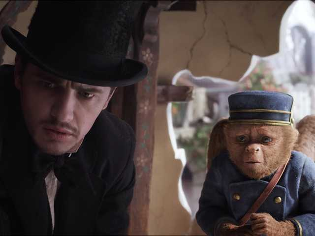 "This film image released by Disney Enterprises shows James Franco, as Oz, left, and the character Finley, voiced by Zach Braff, are shown in a scene from ""Oz the Great and Powerful."" (AP)"