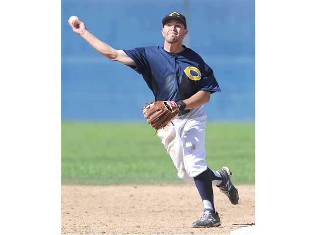 College of the Canyons' Chad DeLaGuerra throws out a runner at first base in the fifth inning against L.A. Valley College. The Cougars won 7-5. Photo by Jayne Kamin-Once/For The Signal