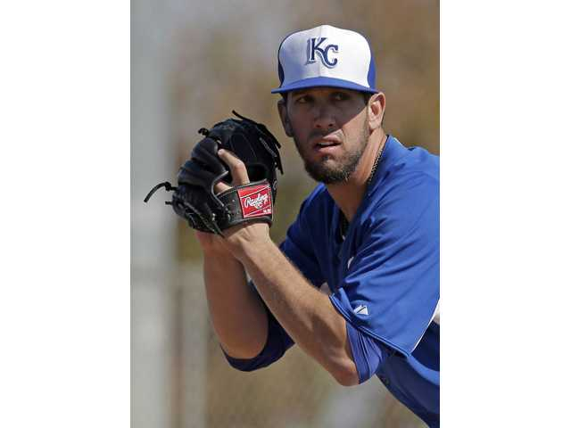 Kansas City Royals pitcher James Shields, a Hart High graduate, gets ready to throw during a Spring Training workout last month in Surprise, Ariz.