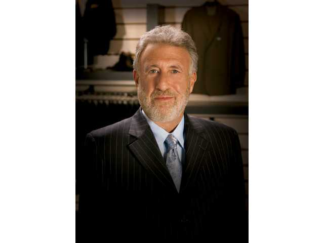 Men's Wearhouse founder to keynote trade show