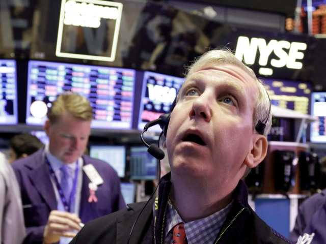 Trader Richard Cohen on the floor of the NYSE Wednesday, after the government reported that U.S. retail sales rose at the fastest pace in five months.