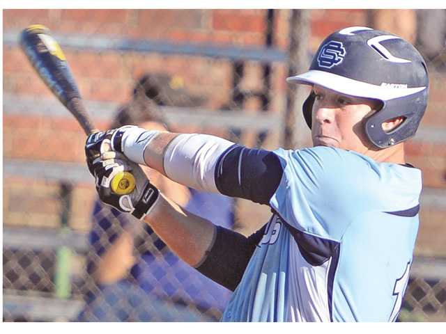 Saugus High's Chris Devery (10) hits an RBI single in the eight inning to give Saugus the lead against Hart High at Hart on Wednesday.