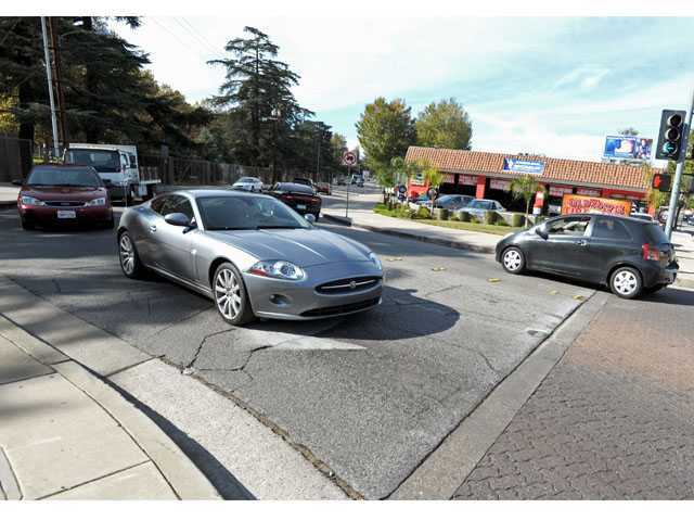 A vehicle moves through the Newhall intersection that is planned for conversion to a roundabout.
