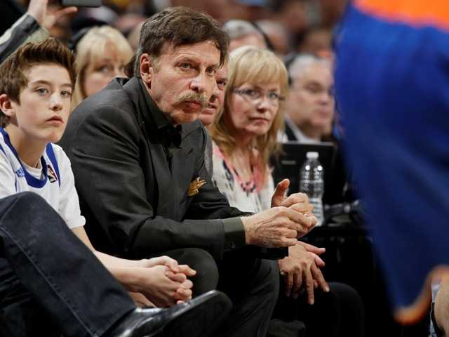Denver Nuggets owner Stan Kroenke is adding the Outdoor Network to his sports empire. Above, he watches from a courtside seat at a Nuggets - New York Knicks game.