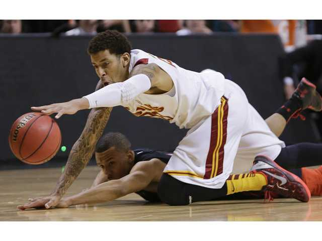 USC's J.T. Terrell (20) and Utah's Glen Dean dive for a loose ball during a Pac-12 tournament game on Wednesday in Las Vegas.