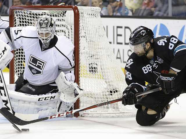 San Jose Sharks' Brent Burns, right, takes a shot on Los AngelesKingsgoalie Jonathan Bernier on Thursday in San Jose.