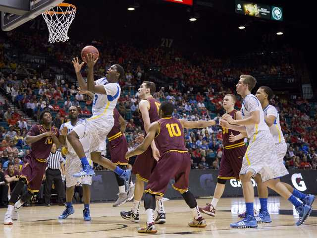 UCLA's Jordan Adams drives in for a layup against Arizona State during the Pac-12 men's tournament Thursday in Las Vegas.