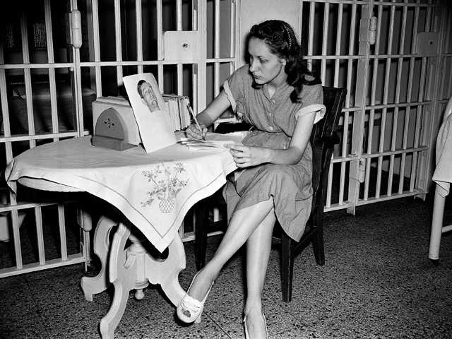 Ruth Steinhagen, 19, held in the shooting of Philadelphia Phillies first baseman Eddie Waitkus at a Chicago hotel on June 14, 1949, writes notes for her life history in Cook County Jail in Chicago. (AP)