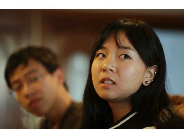 Victoria Hu, 20, right, and her brother Richard talk about their father at their house in Rancho Palos Verdes, Calif. (AP)