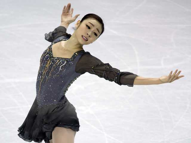 Kim Yu-na, of South Korea, performs in the ladies program at the ISU World Figure Skating Championships in London, Ontario on Saturday. (AP)