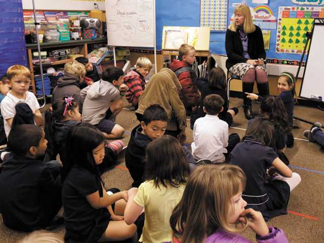 In this Jan. 24, 2013 file photo, first grade teacher Lynda Jensen teaches her class of 30 children at the Willow Glen Elementary School in San Jose.