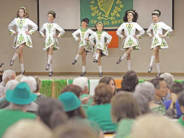 Members of the O'Connor School of Irish Dance perform on stage for the attendees as they dined on corned beef and cabbage.
