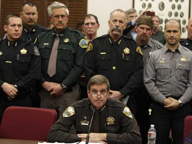 Weld County Sheriff John Cooke, center, testifies against proposed gun control legislation in the Colorado Legislature, at the State Capitol, in Denver, Monday March 4. (AP)