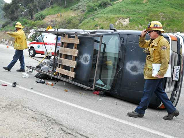 Firefighters work the scene of a two-car crash on Sierra Highway north of Foothall Boulevard in Newhall on Monday. Signal photo by Jonathan Pobre