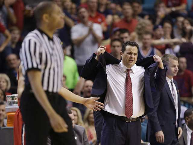 Arizona coach Sean Miller, right, reacts after being called for a technical foul in the second half against UCLA during a semifinal Pac-12 tournament on Friday in Las Vegas. UCLA won 66-64.
