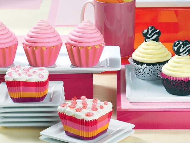 Rose Ombre cupcakes, top left, Zebra Lace cupcakes, right, and Sugar Striped Square cupcakes, bottom. (Family Features)