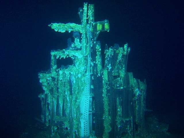 This image provided by Bezos Expeditions shows growths on a Saturn V rocket stage structure on the bottom of the Atlantic Ocean in March 2013. An expedition led by Amazon CEO Jeff Bezos pulled up two rocket engines that helped boost Apollo astronauts to the moon. Bezos and NASA announced the recovery on Wednesday.