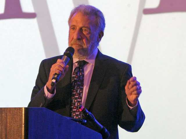 George Zimmer, founder and CEO of the Men's Wearhouse, speaks at the Valley Industry Association's Business-to-Business Industry Show at the Hyatt Regency Valencia on Tuesday.