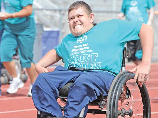 Michael Abbott, 14, of La Mesa Junior High School competes in the 100-yard dash at the annual Hart Games Track and Field Meet, where special needs athletes participated at Valencia High School on Wednesday.