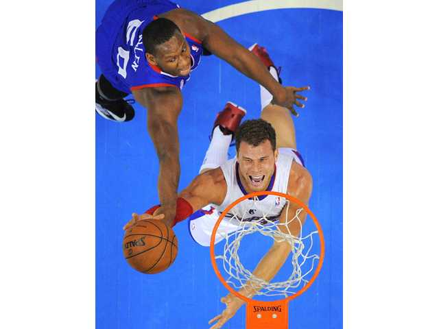 Los Angeles Clippers forward Blake Griffin, below, puts up a shot as Philadelphia 76ers center Lavoy Allen defends Wednesday in Los Angeles.