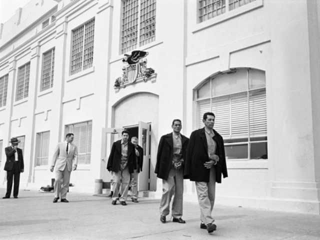 In this 1963 photo prison guard Jim Albright, second from left, leads out the last prisoners from the federal penitentiary on Alcatraz Island. It's been 50 years since it closed.
