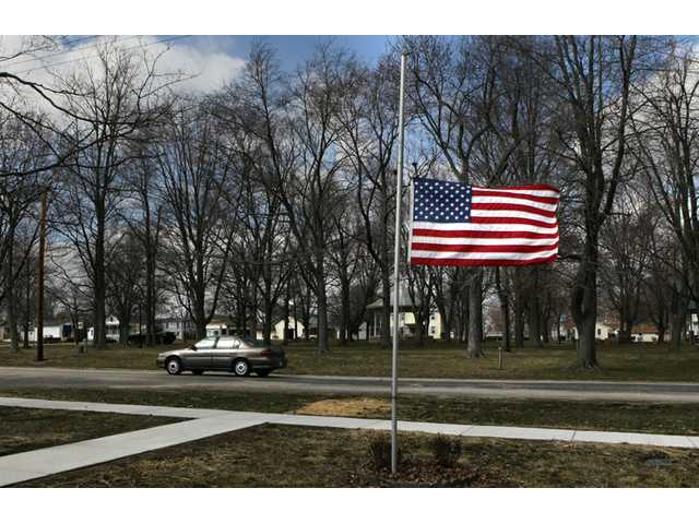 Marine Aaron Ripperda of Highland, Ill. is remembered with flags at half mast in nearby downtown Marine, Ill., where his father lives, on Wednesday.