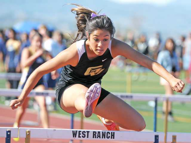 Golden Valley's Caitlyn Zindroski competes in the 100-meter hurdles on Thursday at West Ranch High School.