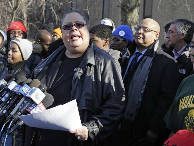 Chicago Teachers Union President Karen Lewis speaks outside the Mahalia Jackson Elementary School in Chicago on Thursday about the planned closing of public schools.