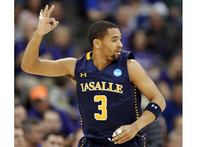 La Salle guard Tyreek Duren (3) celebrates a 3-point basket during the first half of a second-round game against Kansas State in Kansas City, Mo. on Friday.