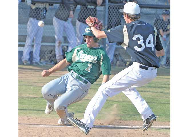 Canyon's Christopher Jenkins (2) scores as he beats the tag by Golden Valley pitcher John Mark Niednagel at Golden Valley High on Friday.