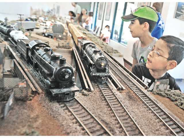 Joshua, 11, and Jerred Lerma, 8, right, get a close-up look at the HO-gauge trains today during the Newhall Train Show. Signal photo by Dan Watson