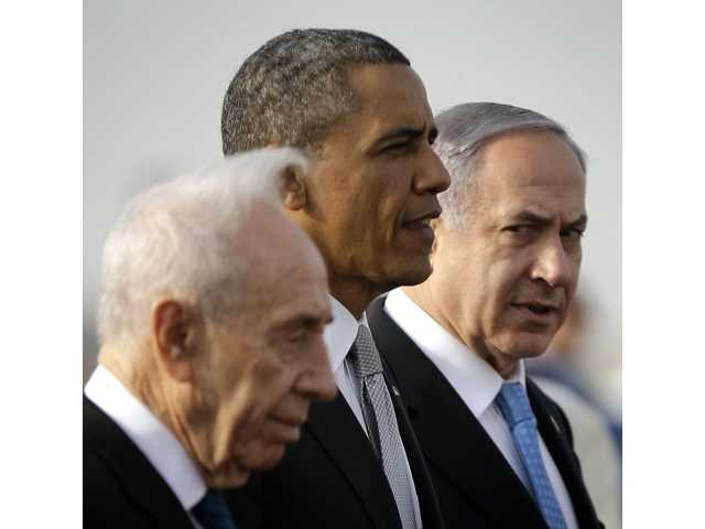 President Barack Obama walks on the tarmac with Israeli Prime Minister Benjamin Netanyahu, right, and Israeli President Shimon Peres, left, prior to his departure from Ben Gurion International Airport in Tel Aviv, Israel on Friday.