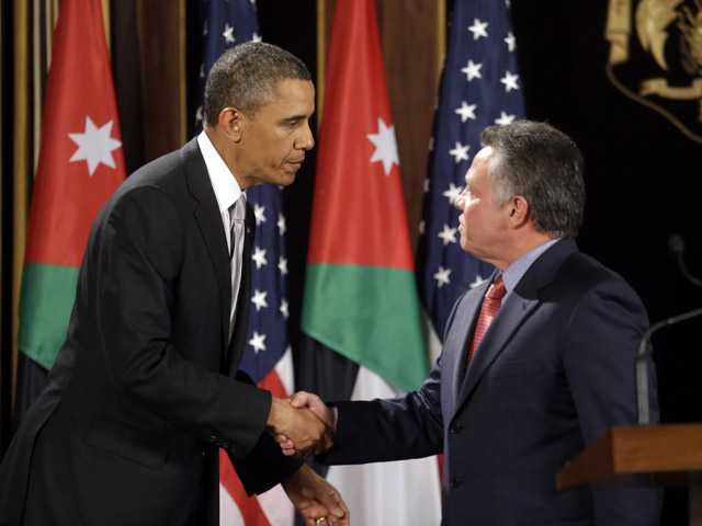 U.S. President Barack Obama, left, and Jordan's King Abdullah II, right, shake hands following their joint new conference at the King's Palace in Amman, Jordan on Friday.
