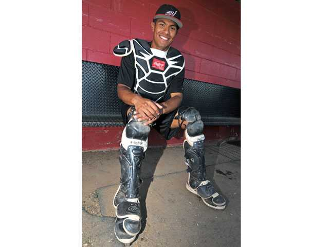 """Hart catcher Baggio Saldivar is also the leader of the Indians' student section, dubbed """"The Tribe""""."""