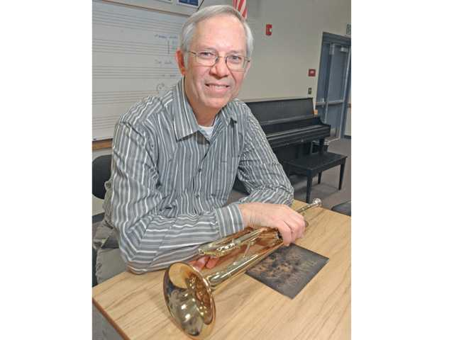 Longtime local school band director Randy Gilpin stands in the music room at Rancho Pico Junior High School on Friday.