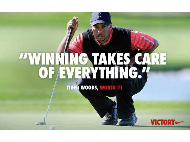 "Nike is causing a social media storm with its latest online ad, seen here, showing a picture of Tiger Woods overlaid with a quote from him, ""Winning takes care of everything."""
