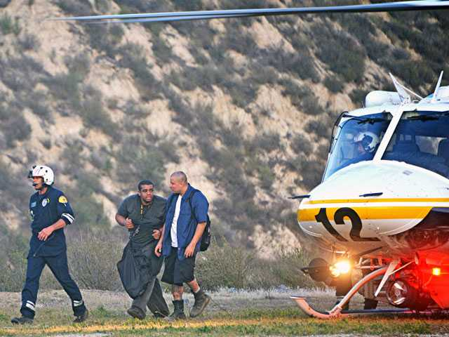 Two victims with minor burns were treated by ground crews after a small brush fire Tuesday evening. Photo by Rick McClure