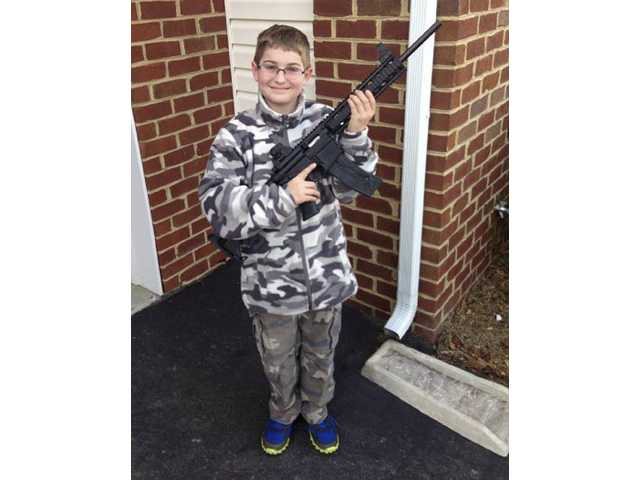 NJ to probe state response in boy-with-gun photo
