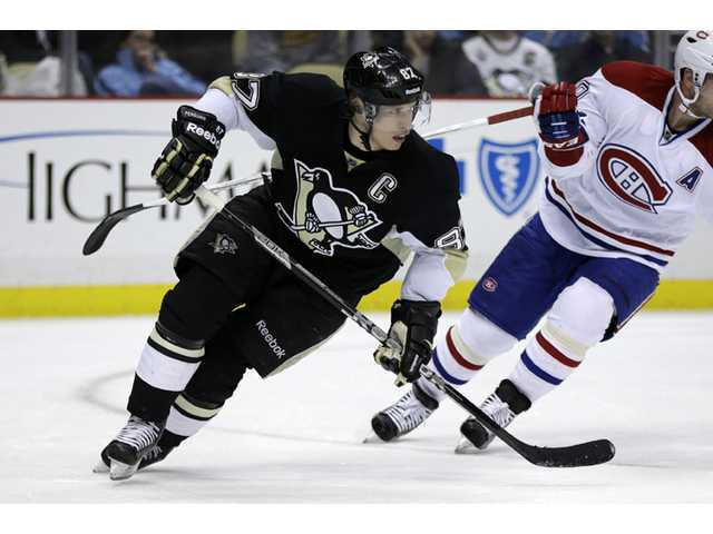 Pittsburgh Penguins center Sidney Crosby (87) skates during a game against the Montreal Canadiens in Pittsburgh on Tuesday.