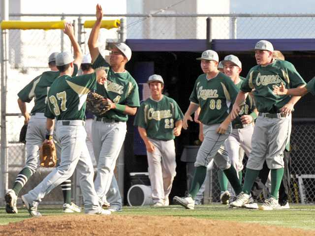 Canyon players celebrate their 2-1 win over Valencia on Wednesday at Valencia High.