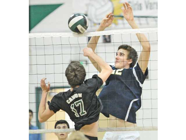 West Ranch's Brenton Scott (42) blocks a shot by Canyon's Andy Kern (17) at Canyon High on Wednesday.