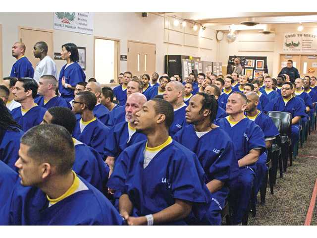 Inmate graduates attend ceremony Thursday at the Pitchess East facility. About 60 were the facility's first graduating class from the Sheriff Department's newly launched program called Education Based Incarceration. Signal photo by Jim Holt