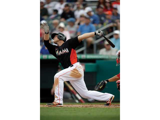 Hart High graduate Chris Valaika earned an opening-day roster spot with the Miami Marlins, the team announced Thursday.