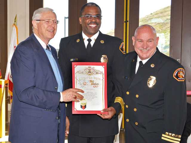 Los Angeles County Supervisor Michael Antonovich presents a county certificate of congratulations Friday to Los Angeles County Fire Chief Daryl Osby and Assistant Fire Chief Dean McGuire upon the official dedication of Fire Station 150 in the Fair Oaks Ranch area of the Santa Clarita Valley. Photo by Rick McClure