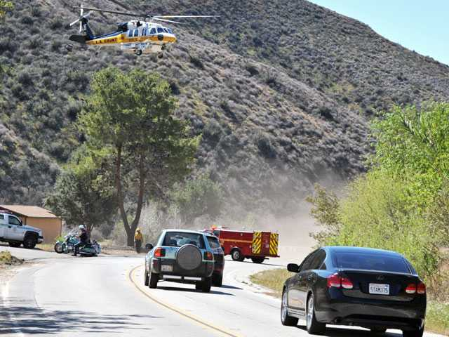 A Fire Department helicopter takes off from the Texas Canyon Fire Station to transport a patient involved in a crash on Bouquet Canyon Road in the Angeles National Forest today. Signal photo by Jonathan Pobre
