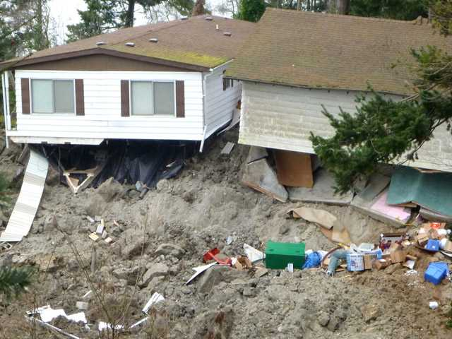 A home that was damaged by the massive landslide that also isolated or threatened more than 30 others near Coupeville, Wash.