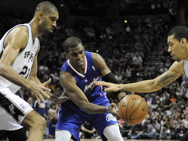 Los Angeles Clippers' Chris Paul, center, loses the ball against San Antonio Spurs' Tim Duncan, left, and Danny Green on Friday in San Antonio. San Antonio won 104-102.